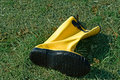 Yellow Boot in Grass Royalty Free Stock Images