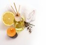 Yellow bottle with essential oil, candle on white Royalty Free Stock Photo