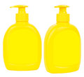 Yellow bottles with liquid soap two plastic dosators isolated on white Stock Photos
