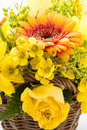Yellow bouquet with different kind of flowers Stock Photo