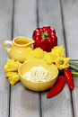 Yellow bowl of pasta and fresh vegetables on old grey wooden table Stock Image