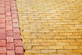 The yellow brick road paving edged with red bricks Royalty Free Stock Photo
