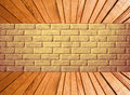 Yellow brick wall and wooden plank floor perspective. Royalty Free Stock Photo
