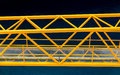 Yellow bridge over blue water a steel ganway deep in the caribbean Stock Photo
