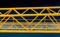 Yellow bridge over blue water a steel ganway deep in the caribbean Stock Photo