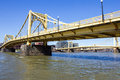Yellow bridges crossing the allegheny painted iron suspension cross icey river toward downtown pittsburgh pennsylvania Stock Photos