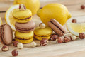 Yellow and brown french macarons with lemon and hazelnuts