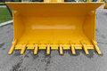 Yellow bucket big scoop at digger machine Royalty Free Stock Photo