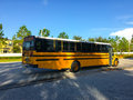 Yellow bus and blue sky Royalty Free Stock Photo