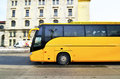 Yellow bus for external public transporation in prague city modern motion near train station building Royalty Free Stock Images