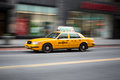 Yellow cab fast moving blurred making its way through manhattan new york Royalty Free Stock Photography