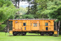 Yellow caboose on old train on display Royalty Free Stock Images