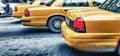 Yellow cabs in city avenue fast speeding, New York City