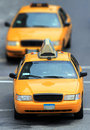 Yellow cabs in city two driving around a Stock Photo
