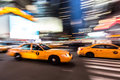 Yellow cabs fast moving blurred making their way through manhattan new york Royalty Free Stock Image