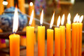 Yellow candles in the temple for worship Royalty Free Stock Photography