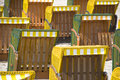 Yellow canopied beach chairs at baltic sea lots of Royalty Free Stock Image