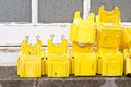 Yellow caps pastic clips used for scaffolding on an exterior window ledge Stock Images