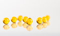 Yellow capsules isolated white Royalty Free Stock Images