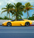 Yellow car on tropical island Stock Photo