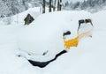 Yellow car under snowdrift. Royalty Free Stock Photo