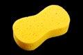 Yellow car wash sponge isolated on the black background Royalty Free Stock Photo