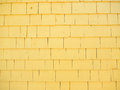 Yellow cedar siding shingles as used on buildings Stock Photography