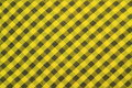 Yellow checked tablecloth background gingham or fabric texture Stock Image