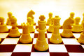 Yellow chessboard and pieces Royalty Free Stock Photo