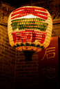 Yellow Chinese lantern in front of old house Stock Photos