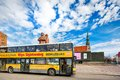 Yellow city sightseeing bus in riga latvia march double decker waiting for tourists on the latvian riflemen square Stock Image