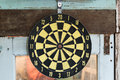 Yellow classic darts board on the old window Royalty Free Stock Photo