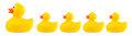 Yellow classic rubber bath duck toy family Royalty Free Stock Photo