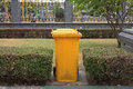 Yellow clean garbage bin in the park Stock Photography