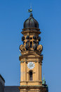 Yellow clock tower teathiner kirche church downtown munich bavaria germany Stock Photos