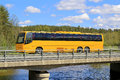 Yellow Coach Bus on Scenic Bridge Royalty Free Stock Photo