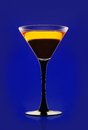 Yellow cocktail on a blue background Royalty Free Stock Photography