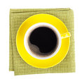 Yellow coffee cup over kitchen towel view from above isolated on white background Royalty Free Stock Photography