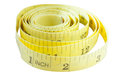 Yellow coiled tape measure Isolated on white background with wit Royalty Free Stock Photo