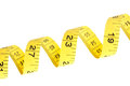 Yellow coiled tape measure on white Royalty Free Stock Photo