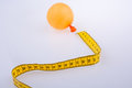 Yellow color measuring tape and a balloon Royalty Free Stock Photo