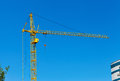 Yellow construction tower crane Royalty Free Stock Photography