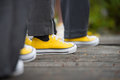 Yellow converse sneakers with grey slacks at a wedding Royalty Free Stock Photo