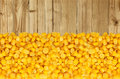 Yellow corn grain isolated on wooden table Royalty Free Stock Photo