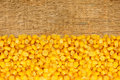Yellow corn grain on wooden Royalty Free Stock Photo