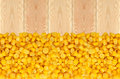 Yellow corn grain on wooden table background Royalty Free Stock Photo