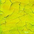 Yellow cracked paint texture Stock Photos
