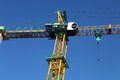 Yellow crane construction against blue sky industrial element Royalty Free Stock Photos