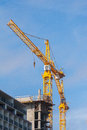 Yellow crane working on a construction site Royalty Free Stock Photography