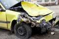 Yellow crashed car traffic accident Stock Images